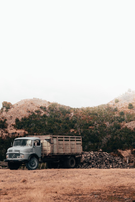 stake truck near hill