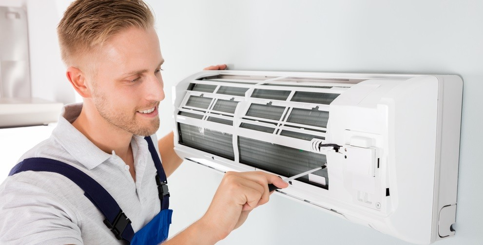 A picture containing person, appliance  Description automatically generated